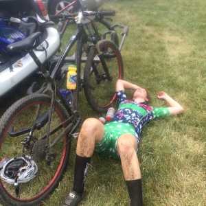 Team Laser Cats mountain bike racer on the ground