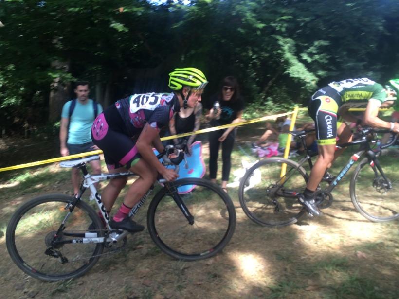 Women racing cyclocross uphill