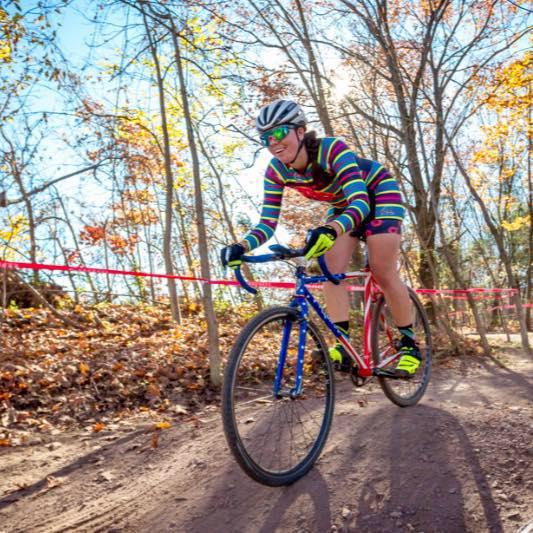 Woman racing cyclocross singlespeed through the woods