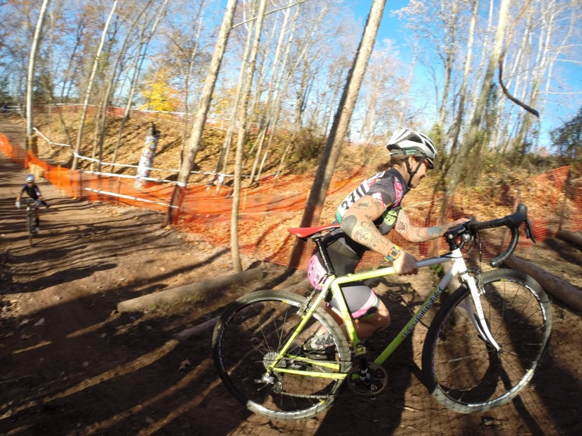 Woman carrying bicycle in a cyclocross race