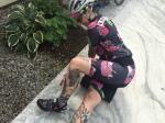 Woman cyclist using foam roller