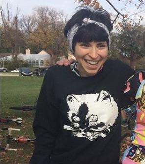 woman smiles wearing cat shirt