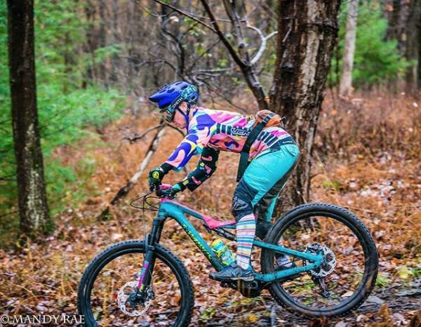 woman racing downhill mountain bike