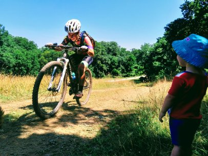 Caitlin Thompson races Granogue under the watchful cheering eye of her daughter, 2018.